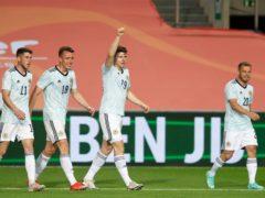 Kevin Nisbet celebrates scoring for Scotland (Miguel Morenatti/AP)
