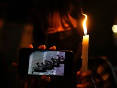 People light candles to mark the anniversary of the military crackdown on a pro-democracy student movement in Beijing, outside Victoria Park in Hong Kong (AP/Kin Cheung)