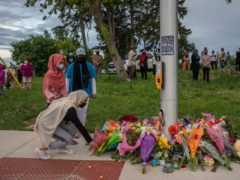 Mourners leave flowers at the site of the attack (Brett Gundlock/AP)