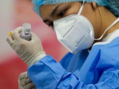 A healthcare worker prepares a dose of the AstraZeneca vaccine (Arnulfo Franco/AP)