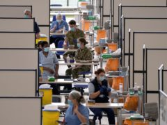 Members of the armed forces assisting the Covid-19 vaccination programme at the Ravenscraig regional sports facility in Motherwell, Scotland (Andrew Milligan/PA)