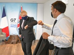 Boris Johnson greets French President Emmanuel Macron at the G7 summit in Cornwall (Stefan Rousseau/PA)