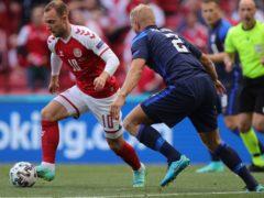 Christian Eriksen, left, collapsed in Denmark's Euro 2020 game against Finland (Friedemann Vogel/AP)
