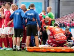 Denmark's Christian Eriksen receives medical treatment (Martin Meissner/AP)