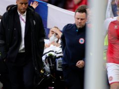 Christian Eriksen left the pitch on a stretcher after he collapsed during Denmark's match with Finland (Friedemann Vogel/AP/PA)
