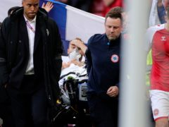 Denmark midfielder Christian Eriksen was carried off the pitch on a stretcher after collapsing during the Euro 2020 match with Finland (Friedemann Vogel/Pool via AP)