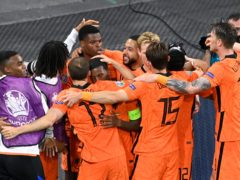 Holland players celebrate Georginio Wijnaldum's opener (AP)