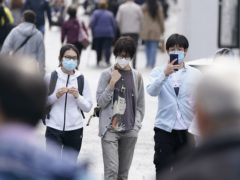 People wearing masks in Liverpool city centre (Peter Byrne/PA)