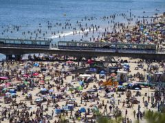 People on the beach in Bournemouth on June 14 (Steve Parsons/PA)