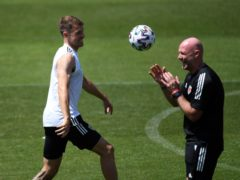 Aaron Ramsey (left) will be hoping to help Wales interim manager Robert Page secure a positive result against Turkey in Baku (PA Wire)