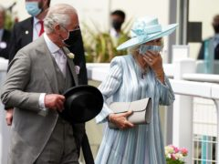 The Prince of Wales and the Duchess of Cornwall on Day One (Andrew Matthews/PA)