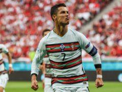 Cristiano Ronaldo celebrates his record-breaking goal against Hungary (Bernadett Szabo/AP)