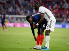 Antonio Rudiger, right, stands beside France's Paul Pogba (Matthias Hangst/AP)