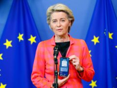 European Commission President Ursula von der Leyen with her EU Digital Covid Certificate (Johanna Geron/Pool Photo via AP)