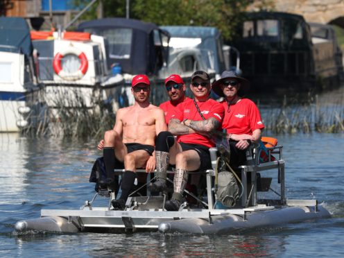 Alex Gibson (left), a GB decathlete who was diagnosed with Motor Neurone Disease four years ago, leads his team of Challenging MND pedallers (second left to right) Andy Long, Joe Reed, and Alun Thomas, as they travel along the River Thames at Newbridge (PA)