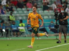 Aaron Ramsey celebrates scoring Wales' opener in their 2-0 victory over Turkey in Baku (Tolga Bozoglu/AP)