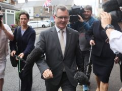 DUP MP Sir Jeffrey Donaldson arrives at the DUP headquarters in Belfast (PA)