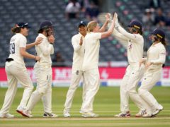 England's players celebrate a wicket (Zac Goodwin/PA)