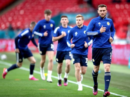 Scotland's Stephen O'Donnell, right, warms up at Wembley (Nick Potts/PA)