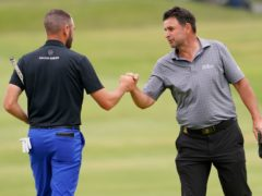 Richard Bland (right) fist bumps Troy Merritt after their second round in the US Open (Jae C. Hong/AP)