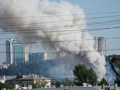 Smoke rises from a fireworks warehouse in Moscow (Pavel Golovkin/AP)