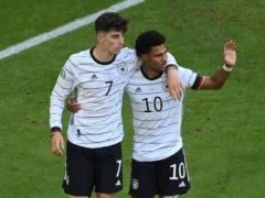 Kai Havertz, left, celebrates with Serge Gnabry after scoring his side's third goal (Matthias Hangst/Pool Photo via AP)
