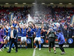 Hartlepool players celebrate with the trophy after winning promotion in the Vanarama National League play-off final (Nigel French/PA)