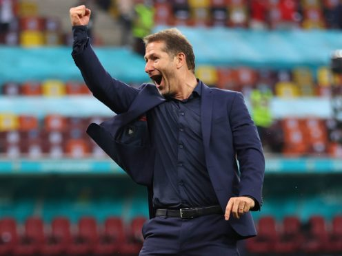 Franco Foda celebrates Austria's win over Ukraine (Marko Djurica/AP).