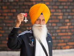 'Skipping Sikh' Rajinder Harzall received his MBE from the Prince of Wales at St James's Palace in London (Dominic Lipinski/PA)