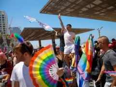 The Pride parade in Tel Aviv attracted tens of thousands of revellers (Ariel Schalit/AP)