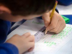 A record £215 million will be spent on efforts to close the attainment gap in 2021-22 (Danny Lawson/PA)