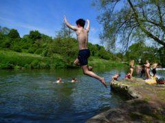 Swimmers enjoy the hot weather at Warleigh Weir, Bath (Ben Birchall/PA)