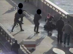 Usman Khan surrounded by armed police officers (Metropolitan Police/PA)