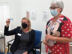 Gateshead's Director of Public Health Alice Wiseman (left) with retired GP Joan Bryson who vaccinated her with a second dose of the AstraZeneca vaccine at a health centre in Blaydon, Tyneside (Tom Wilkinson/ PA)
