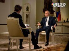NBC News journalist Keir Simmons, left, speaks with Russian President Vladimir Putin (NBC News via AP)