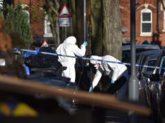 Police at the scene in Linwood Road, Handsworth, where a 15-year-old boy died (PA)