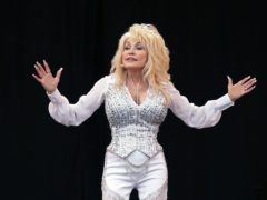 Dolly Parton recreated a Playboy photoshoot from 1978 to surprise her husband for his 79th birthday (Yui Mok/PA)