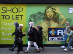 Shoppers walk past a closed down shop in Nottingham (Tim Goode/PA)