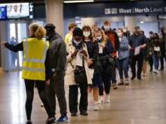 People queue at an NHS vaccination clinic at Tottenham Hotspur's stadium in north London (Yui Mok/PA)
