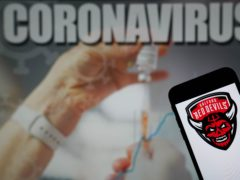 File photo dated 09-01-2021 of The Salford Red Devils logo seen displayed on a mobile phone with a Coronavirus illustration on a monitor in the background. Issue date: Tuesday June 22, 2021.