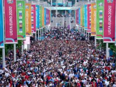 Fans leave Wembley stadium following the UEFA Euro 2020 round of 16 match between England and Germany at the 4TheFans fan zone outside Wembley Stadium (Zac Goodwin/PA)