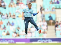 England's Sam Curran celebrates taking the wicket of Sri Lanka's Kusal Perera during the second one day international match at Kia Oval, London.