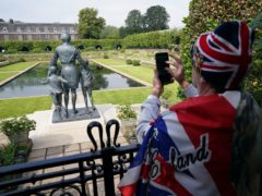 Members of the public view the statue of Diana, Princess of Wales (Jonathan Brady/PA)