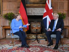 Prime Minister Boris Johnson with the Chancellor of Germany, Angela Merkel, before their bilateral meeting at Chequers (Stefan Rousseau/PA)