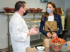 The Duchess of Cambridge, Patron of the All England Lawn Tennis Club, tries her hand at preparing some of the world famous Wimbledon strawberries (Thomas Lovelock/AELTC Pool/PA)