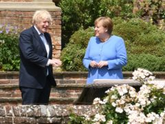 German Chancellor Angela Merkel said travel restrictions are being reviewed for Britons who have received two coronavirus vaccinations, after holding talks with Prime Minister Boris Johnson at Chequers (Stefan Rousseau/PA)