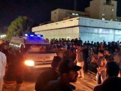 People gather outside the hospital in Nasiriyah, Iraq (Str/AP)