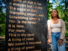 Artist Khady Gueye in the Forest of Dean, with her artwork, in collaboration with poet Zakiya McKenzie and the Sculpture Trust, titled 'Soil Unsoiled', reflecting racial and social economic inequalities in society and the experiences she has endured living in the Forest of Dean, as part of the 35th anniversary year of the sculpture trail at Forestry England's Beechenhurst site, due to be unveiled to the public on Monday. Picture date: Friday July 16, 2021.