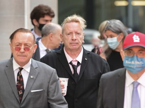 John Lydon, aka Johnny Rotten, centre, arrives at court (Ian West/PA)
