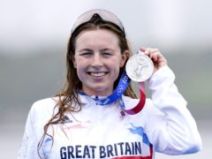 Great Britain's Georgia Taylor-Brown holds up her silver medal (Danny Lawson/PA)